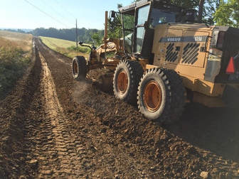 Cover the windrowed soil to let the road treatment rest