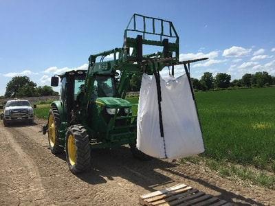 A fork lift may be used to easily load the drop spreader.