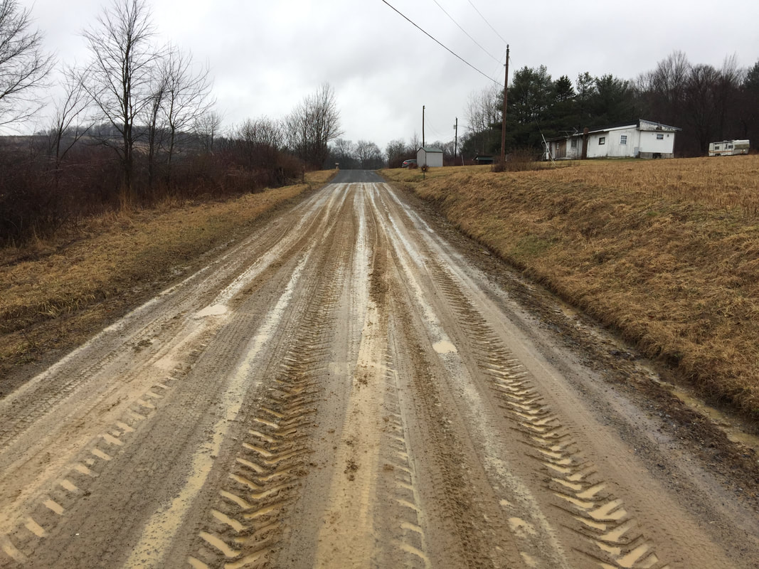 Muddy road before TerraZyme application